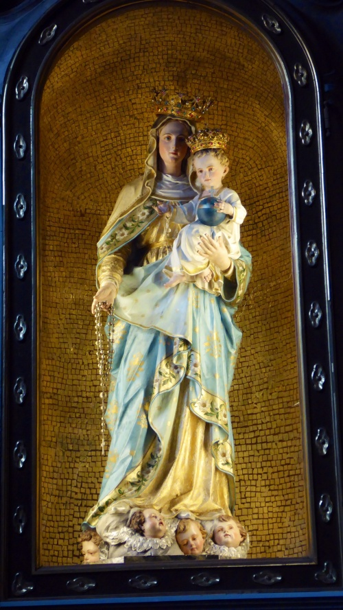 A much more traditional statue of the Madonna and child.