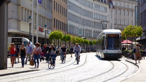 Bicycles share the road with trams, buses and pedestrians.