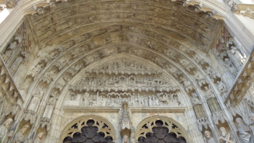 Intricate and very old sculptures above the front door of the Dom in Augsburg