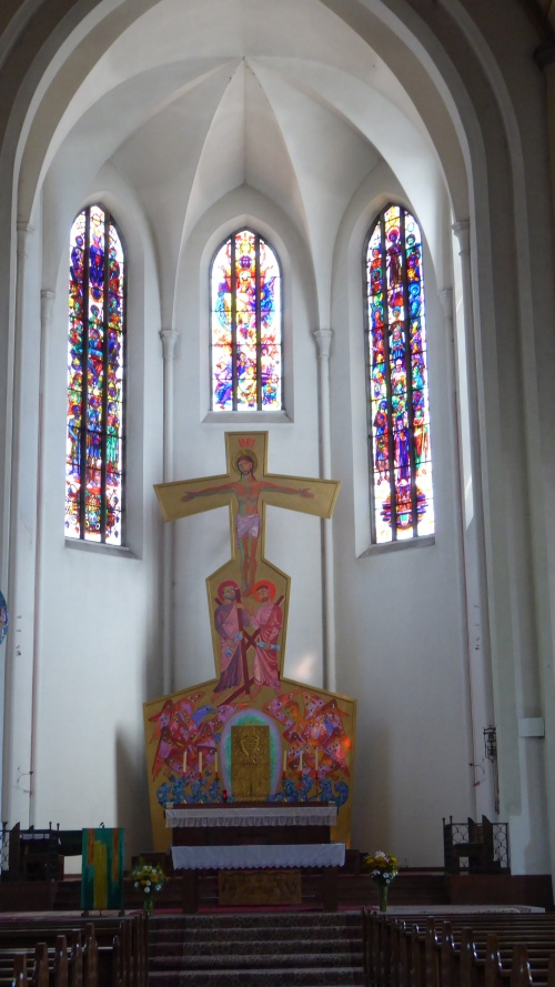 Modern altar and stain glass windows of St Andras Kirche on Mirabellaplatz, Salztburg.